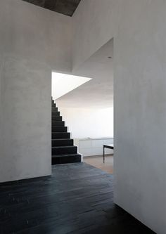 We love the soft contrast and the way the space beckons you to come inside.