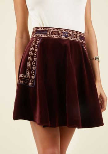 Stop everything and take this skater skirt for a spin! With gold-and-navy geometric embroidery stitched into its beautifully burgundy velvet, this pull-on mini commands your complete focus, ensuring its status as the sole statement-maker of your ensemble.