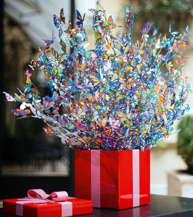 GIFT OF LIFE Artwork Free Standing Sculpture by David Kracov  Countless butterflies are flying outside of the present box and create a colorful cloud of happiness.