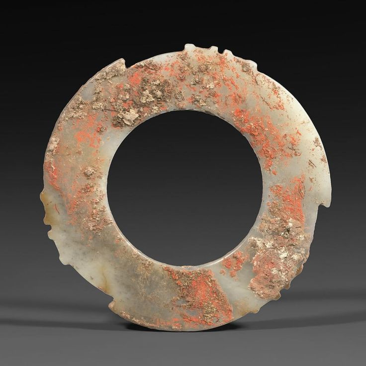A Jade Notched Disc (Yabi) Late Neolithic Period/Shang Dynasty, circa 2000–1500 B.C. Diameter: 4 1/4 inches (10.8 cm) Courtesy of #AsiaWeekNY 2016 dealer J. J. Lally & Co.