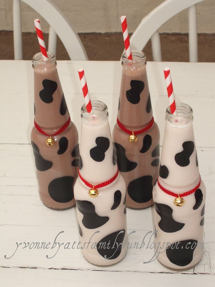 cow hide milk bottles. Use plastic milk bottles (i.e., Target, Donut Store). Just remove labels and paint cow spots on the outside.