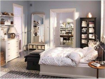 Shorter dresser with shelves above.  Basket next to dresser.