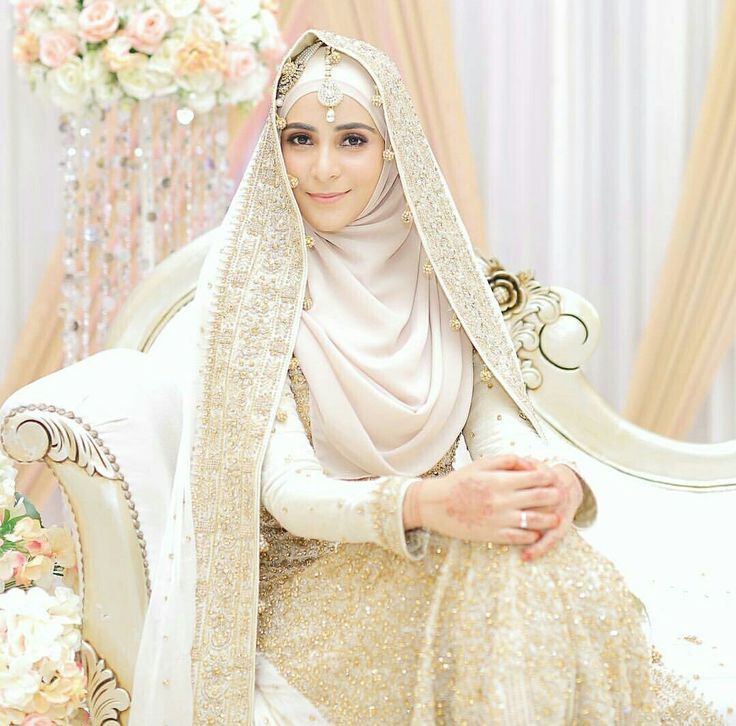 Ideas for gold and cream wedding,look at the wedding veil....it's so beautiful with the wedding hijab? Photo by ikhwanmalik