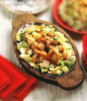 A crispy chinese sizzler combining delicious wontons with popular sweet and sour vegetables.