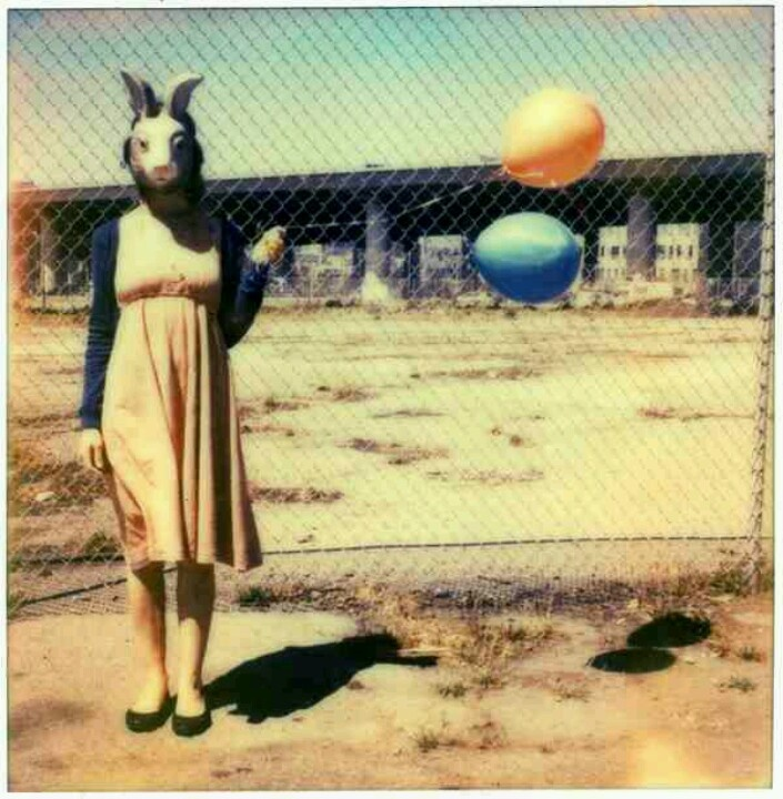 Circus, fence, girl with balloons, bunny mask