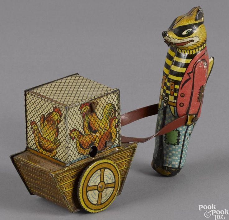 Argentina tin lithograph wind-up fox pushing a cart with a hen house, 4 1/2'' h. - Price Estimate: $150 - $250