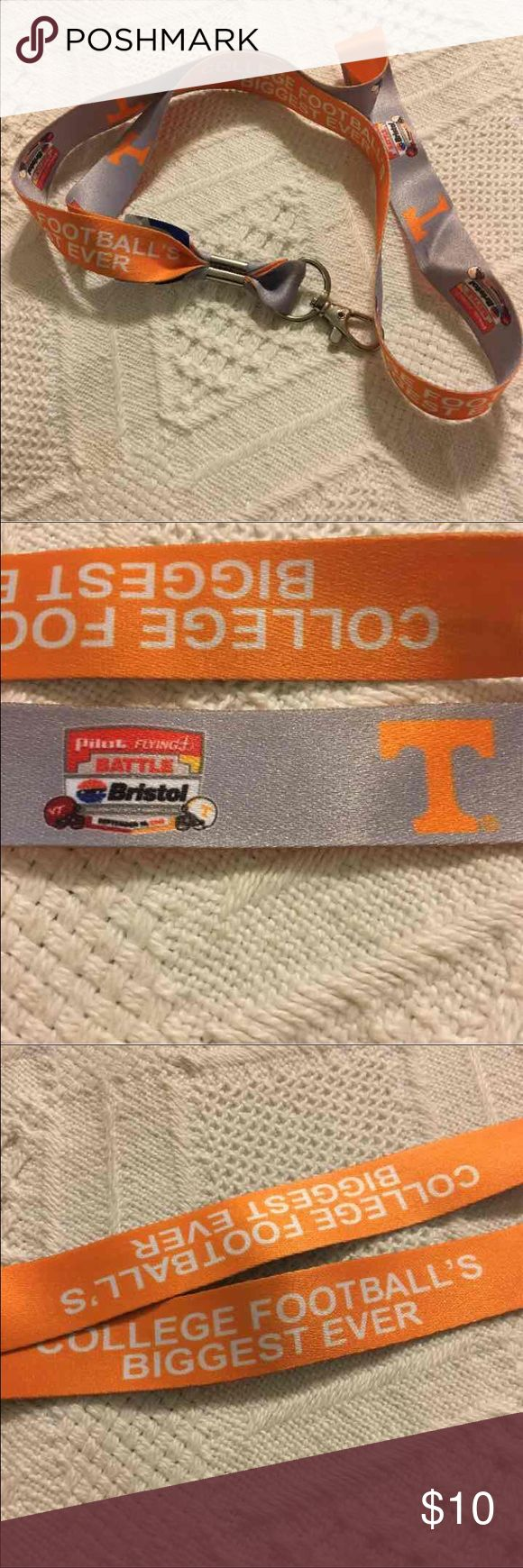 Tennessee Volunteers Battle at Bristol Lanyard NEW Tennessee Volunteers Battle at Bristol Lanyard.  Brand new.  Commemorative lanyard from college football's largest football game ever. Game played at Bristol Motor Speedway between University of Tennessee Volunteers and Virginia Tech Hokies. Accessories Key & Card Holders