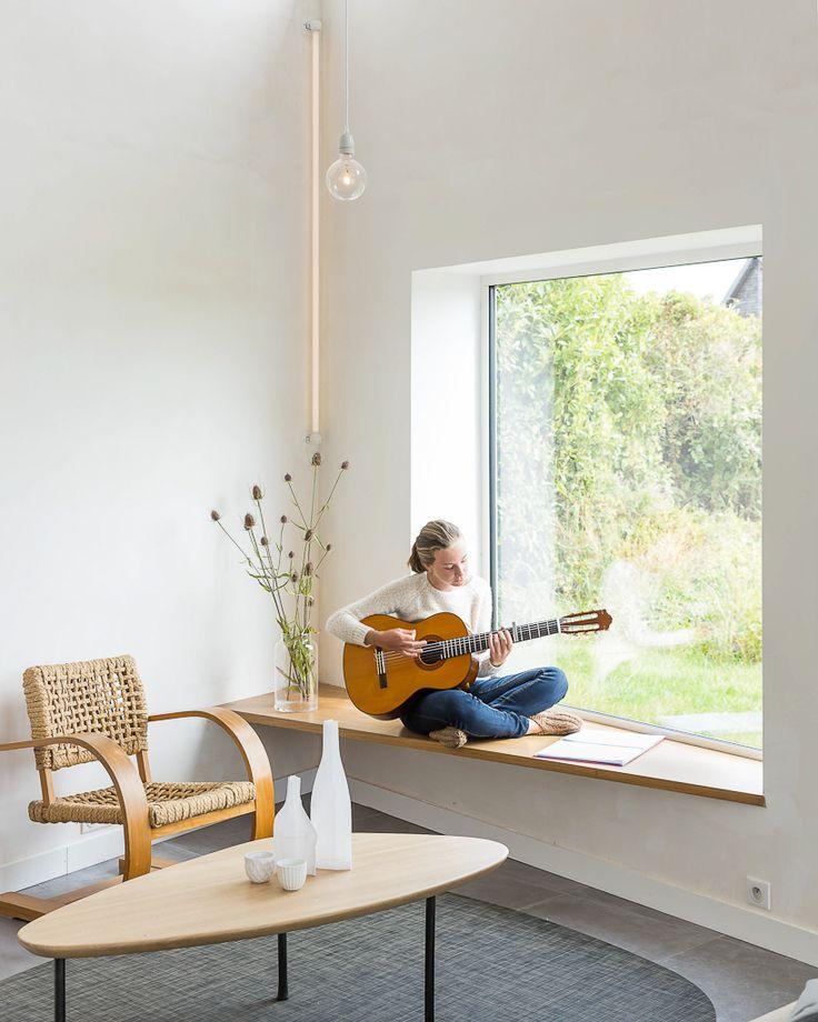 studio razavi adds square openings to define photographer's house façade in…