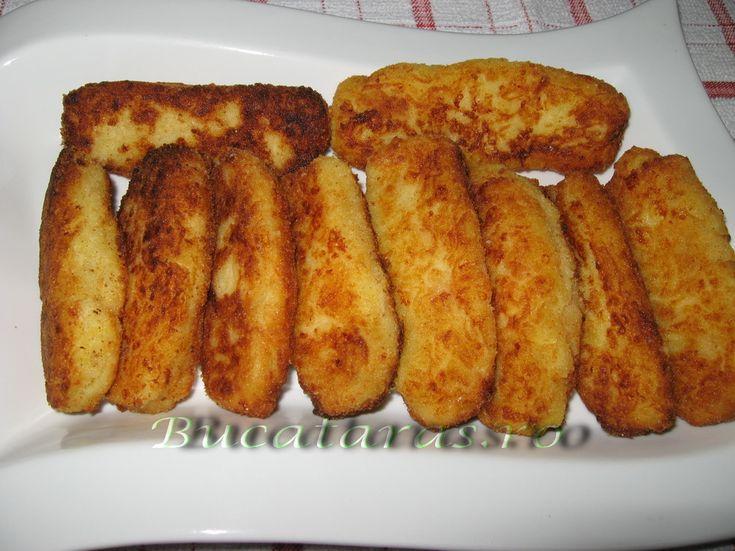 Reteta culinara Crochete de cartofi si cascaval din categoria Aperitive / Garnituri. Specific Romania. Cum sa faci Crochete de cartofi si cascaval