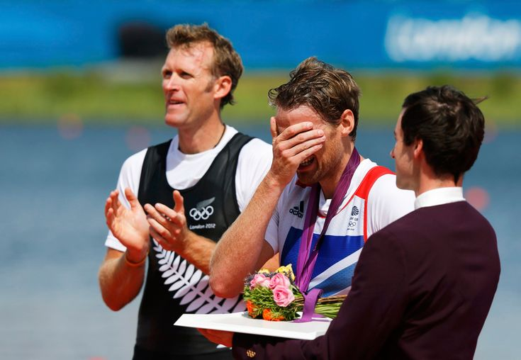 Gold medallist Mahe Drysdale of New Zealand applauds as bronze medallist Alan Campbell of Britain reacts during a ceremony after the Men's Single Sculls Final event at Eton Dorney, Aug. 3, 2012
