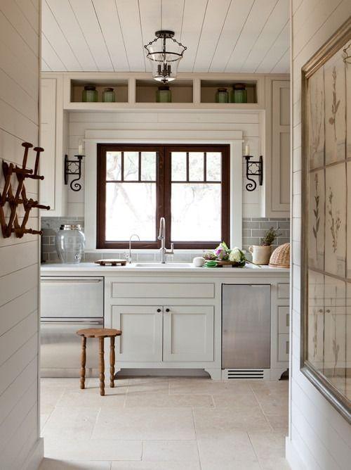 dark stain on window panes in white kitchen: