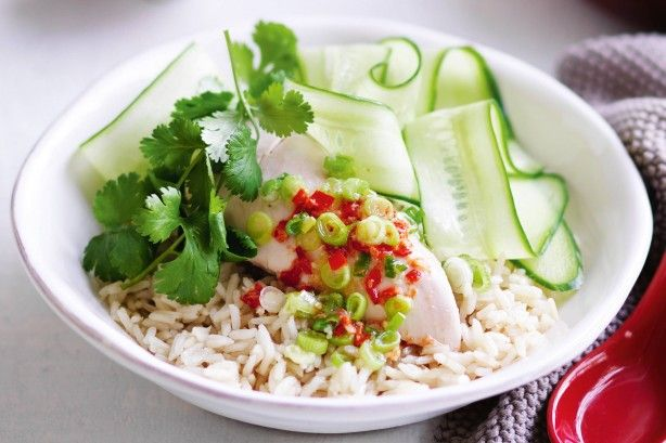 Create a healthy Asian-inspired dish with this ginger-infused chicken served with rice and homemade chilli sauce.