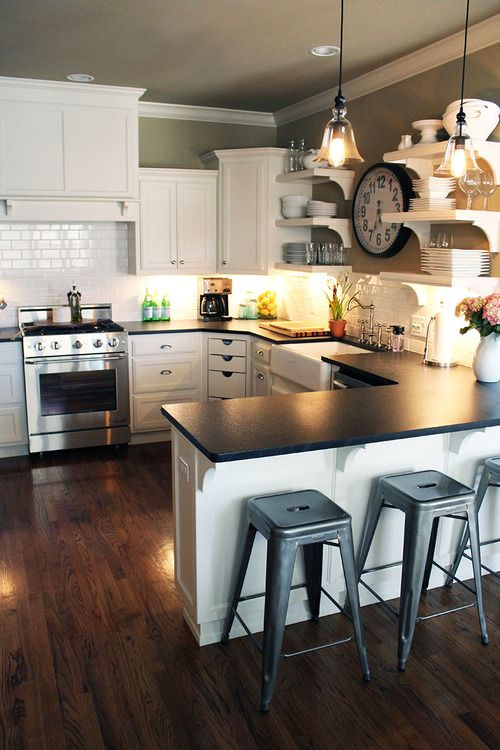 White kitchen, open shelves, Tolix® stools