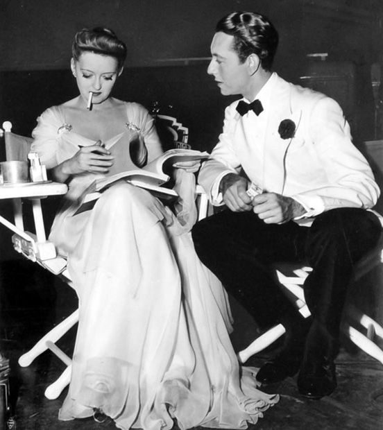 """Now, Voyager"" (1942)  Bette Davis and Paul Henreid between scenes"