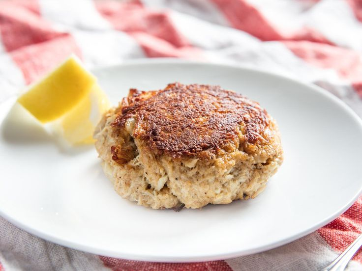 Real Maryland crab cakes are all about the pure indulgence of crab, with as little filler and breading as possible to get in the way. Here's how to make them so that they come out deeply flavorful, with large chunks of perfectly seasoned crabmeat, every time. To be honest, they're so good that they don't even really need the lemon wedge, or condiments like tartar sauce.