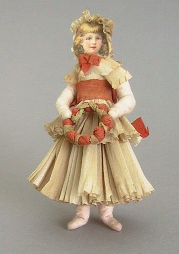 German cotton ornament with elaborate crepe outfit and scrap face, circa 1900