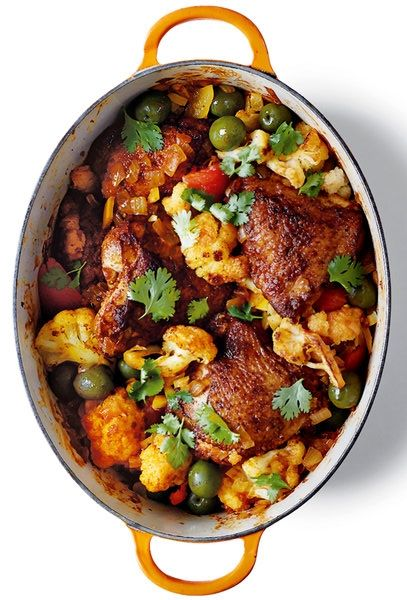 Chicken serves as the protein, bathed in a blend of North African spices — cinnamon and coriander, turmeric, ginger powder and cardamom — combined with tomatoes, saffron and a little stock. Preserved lemons and olives added at the end provide bite. (Photo: Christina Holmes for The New York Times)