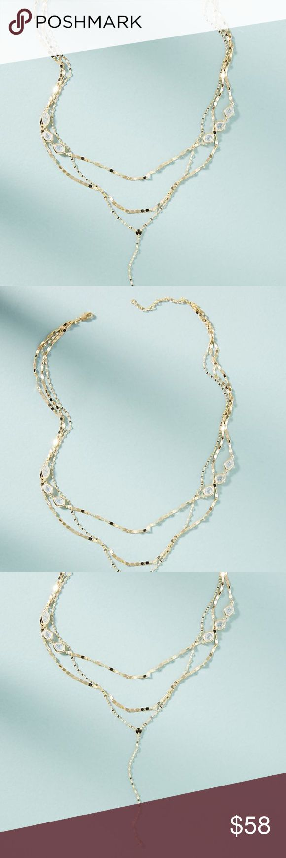 Anthropologie Janis Crystal Layered Necklace NWT Anthropologie Janis Layered Y-Necklace Brand new with tag, completely sold out in stores. Glass beads shimmer and shine on this beautifully layered necklace - it's a delicate yet statement-making addition to any outfit. For sale is the blue colored glass crystal dainty gold tone necklace. So so pretty!  Priced at 58 and ready to drop price to 52 so that you can get discounted shipping. just message me if you are ready to purchase.   Lobster…