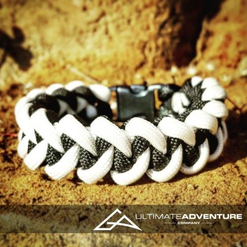 White and Black Jawbone Paracord Survival Bracelet from www.ultimateadventures.co.za  #white #black #sharksjawbone #jawbone #bracelet #paracord #paracord550 #paracordsurvival #paracordsurvivalbracelet #survival #paracordporn #outdoorgear #survivalbracelet