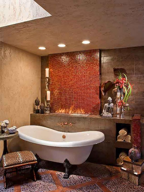 Dramatic Asian Bathroom: A marble mosaic wall is the main feature which forms the backdrop for the original clawfoot tub. A storage niche for towels, bath products and decor, sits behind the tub and becomes a storage niche. The shelf seamlessly displays the homeowners Asian inspired sculptures, wall art and accessories.