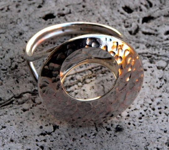 Le Metissage   silver ring with hammered effect circle
