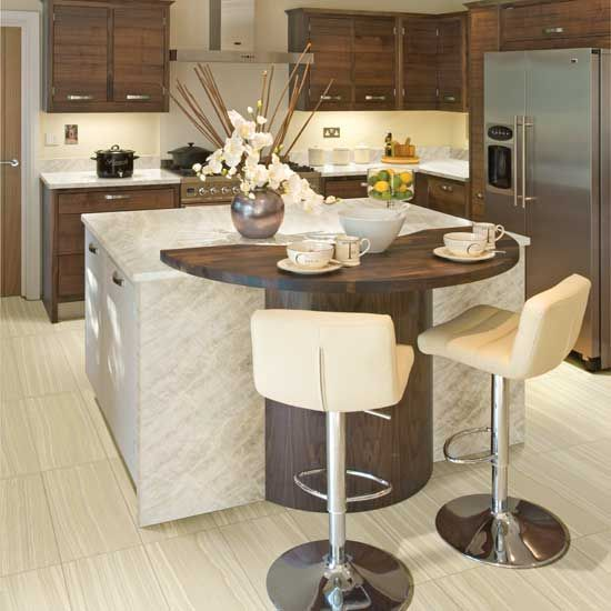 Photo features Chiaro 12 x 24 field tile on the floor in a grid pattern with Crystallize quartzite slab on the island.