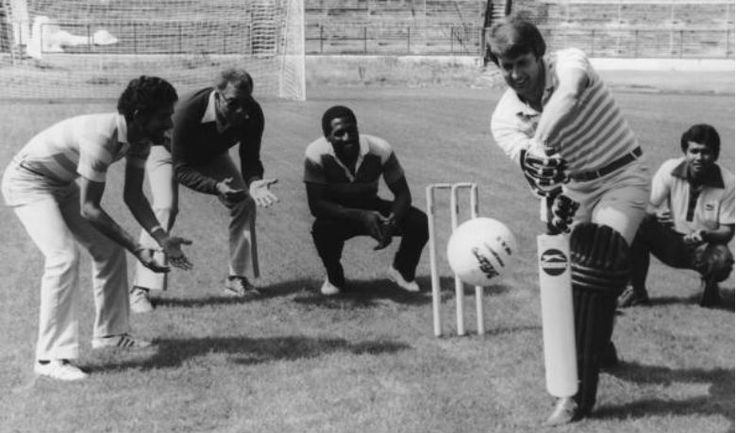 Football legend Geoff Hurst plays cricket with the members of West Indian side