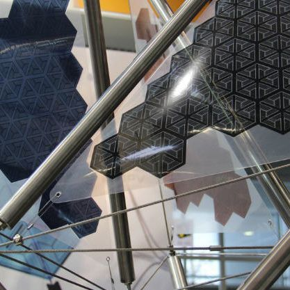 Cable-and-membrane tensile structure / for facades / with solar membrane OPV Carl Stahl GmbH
