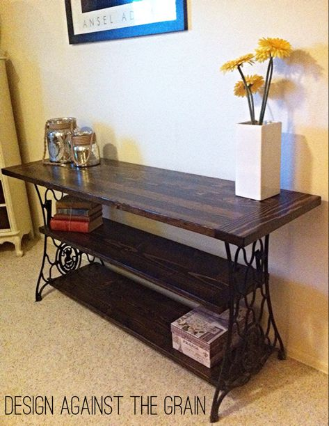 Repurposed console table from antique Cast iron sewing machine base this maybe with middle shelf using treadle?