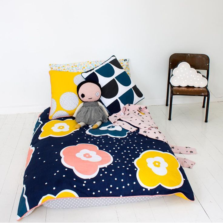 Gender neutral bed linen and pared back furniture makes this room stand out. Our petite cloud night light is perfect in this minimal children's bedroom!