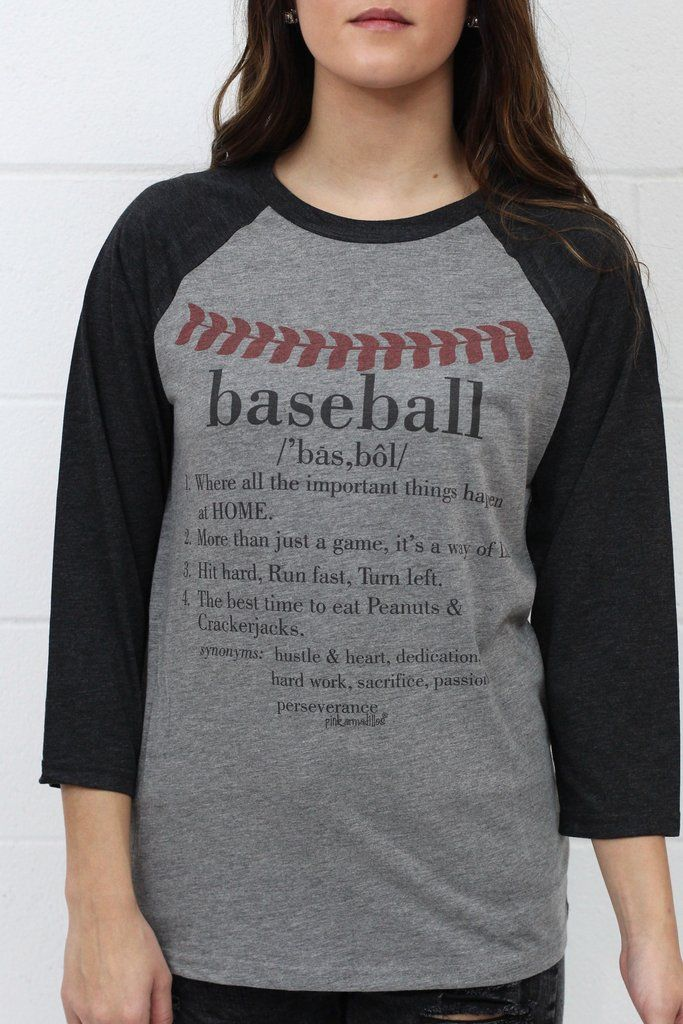 """Baseball raglan featuring a seam graphic with a baseball definition underneath it. """"Baseball: 1. Where all the important things happen at home. 2. More than just a game, it's a way of life. 3. Hit hard, run fast, turn left. 4. The best time to eat peanuts and cracker jacks. Synonyms: hustle & heart, hard work, dedication, sacrifice, passion, perseverance."""""""
