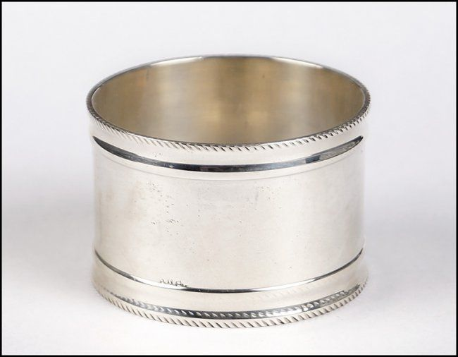 SET OF TWELVE STERLING SILVER NAPKIN RINGS On Silver