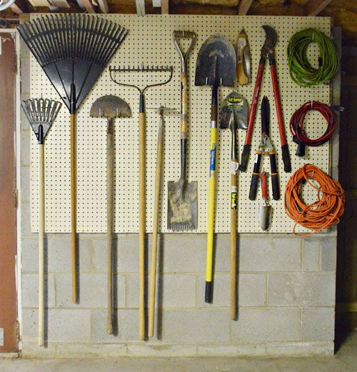 Hanging yard tools on a pegboard for some much-needed basement organization