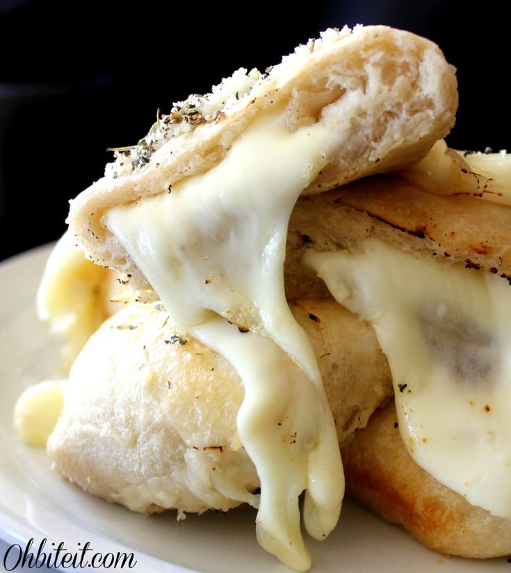 Recipe for Cheesy Biscuit Bombs - Not only do these fluffy, tender cheese filled Biscuits jazz up any meal..they can almost BE the meal! With a long-range Cheese stretch that's capable of reaching you from miles away, escape is not possible!