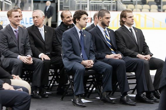 Rand Pecknold (QU - Head Coach), Jerry York (BC - Head Coach), Tony Penna, SJ, and Bob Motzko (SCSU - Head Coach) (hidden) sat behind Johnny Gaudreau (BC - 13), Eric Hartzell (QU - 33) and Drew LeBlanc (SCSU - 19). - The Hobey Baker Award ceremony was held on Friday, April 12, 2013, at the Consol Energy Center in Pittsburgh, Pennsylvania with the members of the Hobey Hat Trick and their families and coaches participating.