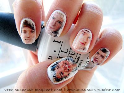 To share with my nieces! One Direction Nails! My 13yo will love these, I however will try the method with different pics. Nail design by Brittney at preciouspolish.com The method involved printing tiny pictures of the boys' faces onto a piece of newsprint. Then dipping each image into rubbing alcohol (isopropyl) and rolled onto the nail to transfer it.
