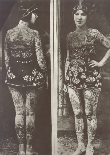 """Lady Viola (originally born as Ethel Martin) Covington, Kentucky, 1898; tattooed by Frank Graf (Coney Island) in the 1920s.  She became a tattoo attraction, billed as """"the most beautiful tattooed woman in the world""""; she wasn't only a circus tattooed lady but also a tattoo artist: in 1970, at the age of 73, she was known as the oldest performing tattoo artist in the world."""