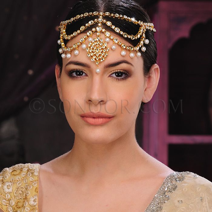 ACR/1/3405 Matha Patti in dull gold finish studded with kundan and hanging pearl droplets  $248 £146