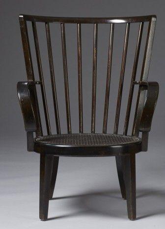 """Axel Einar Hjorth 1888‑1959. Fåtölj. """"Bridge"""" för Nordiska Kompaniet, 1930-tal. Märkt med metallbricka """"NK R 35412 - C 27 1 32"""". Bonad björk. Sits i flätad rotting med lös stoppad dyna klädd med hästtagel. H 88 cm. An Axel Einar Hjorth """"Bridge"""" easy chair. Height 88 cm. Modellen formgiven 1931."""