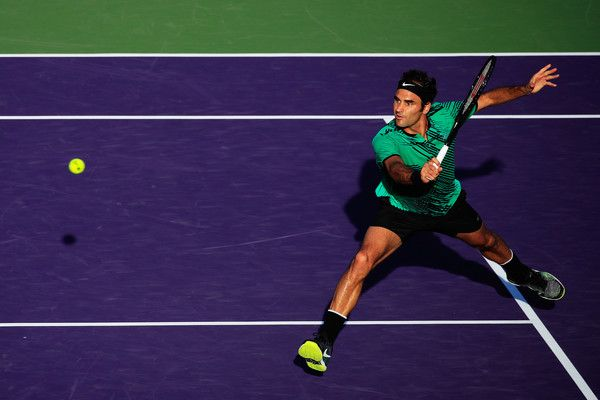 Roger Federer Photos Photos - Roger Federer of Switzerland returns a shot to Roberto Bautista Agut of Spain during Day 9 of the Miami Open at Crandon Park Tennis Center on March 28, 2017 in Key Biscayne, Florida. - 2017 Miami Open - Day 9