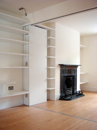 I Love this divider wall.  Could be perfect for slitting off a living room and making either an extra sleeping area or sound barrier.