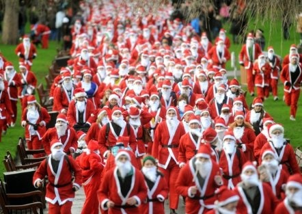 How many Santas does it take to do the job of one saint?