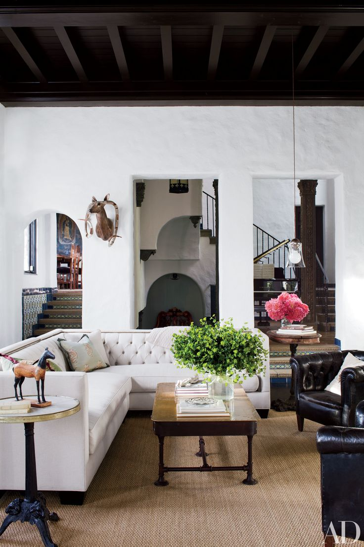 The living room of this Hollywood, California, estate features a Ginebra sectional sofa and vintage cocktail table from 22 Bond St.; the sea-grass rug is by Pottery Barn.