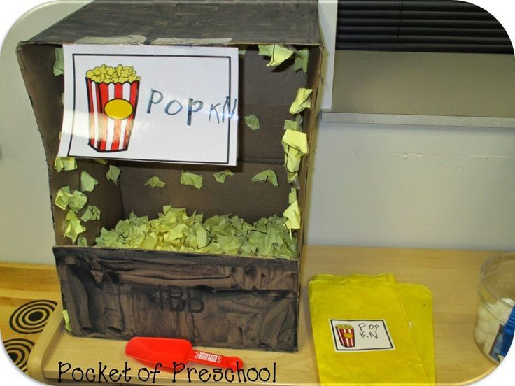 Ice Skating Rink in the Dramatic Play Center:  student created popcorn machine, popcorn made from cut paper, and popcorn bags.  Pocket of Preschool