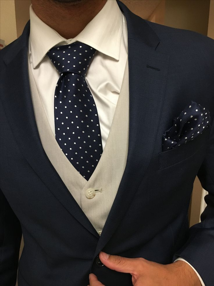 I can't believe I get to marry this man <navy suit, white shirt, beige vest, navy polkadot tie and pocket square>