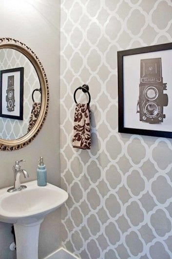 A DIY stenciled powder room using the Rabat Allover Stencil in a light gray. http://www.cuttingedgestencils.com/moroccan-stencil-pattern-3.html