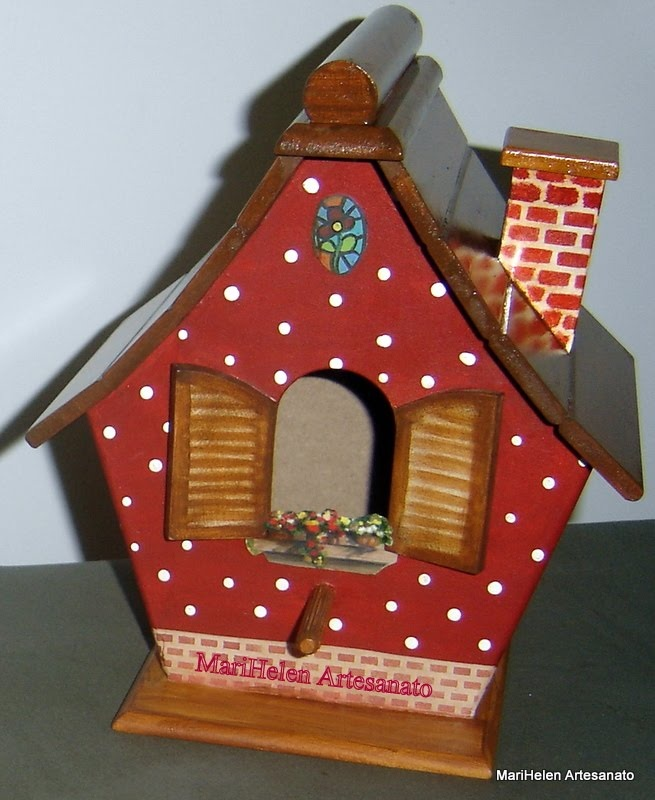 I know - it's a birdhouse - but I like the idea for a painted rock house.