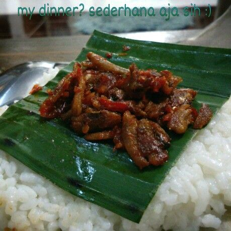 Nasi kucing - the cheapest food in Yogyakarta, Indonesia..contain of rise and spicy sambal (made of chilli, etc)..only Rp 1,000 :)