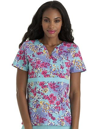 Style Code: (UR-9573SA)  Add a little zip to your wardrobe! This scrub top has hidden zipper front and empire waistline and modified sweetheart neckline. Top applied grosgrain ribbon extends to side princess seams. It has also bustline darts, two double pockets and side vents for ease of movement.