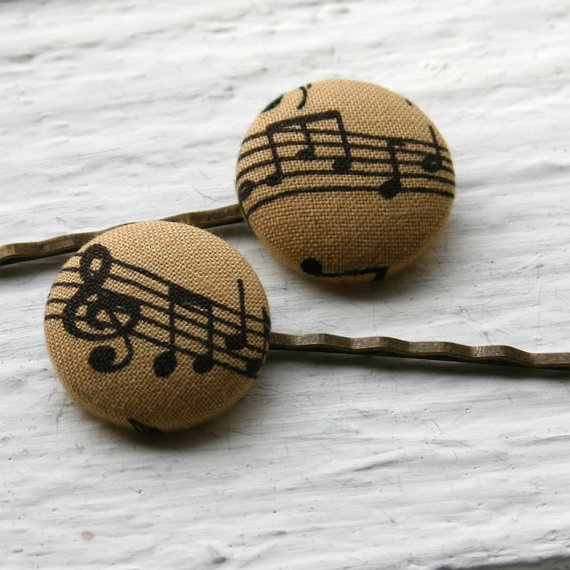 Black on tan sheet music fabric covered button on antiqued bronze bobby pins.